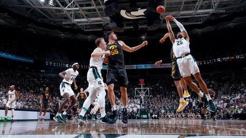 <p>               Michigan State's Malik Hall, right and Iowa's Luka Garza (55) and Michigan State's Thomas Kithier, left, vie for a rebound during the first half of an NCAA college basketball game, Tuesday, Feb. 25, 2020, in East Lansing, Mich. (AP Photo/Al Goldis)             </p>