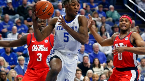 <p>               Kentucky's Immanuel Quickley (5) passes near Mississippi's Blake Hinson (0) and Khadim Sy (3) in the first half of an NCAA college basketball game in Lexington, Ky., Saturday, Feb. 15, 2020. (AP Photo/James Crisp)             </p>