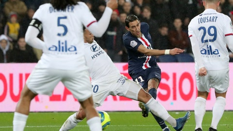 <p>               PSG's Angel Di Maria, center, scores the opening goal during the League One soccer match between Paris Saint Germain and Lyon at the Parc des Princes stadium in Paris, Sunday, Feb. 9, 2020. (AP Photo/Thibault Camus)             </p>