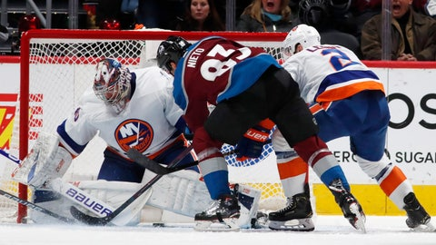 <p>               New York Islanders goaltender Semyon Varlamov, left, stops a shot by Colorado Avalanche left wing Matt Nieto as Islanderss defenseman Nick Leddy covers during the second period of an NHL hockey game Wednesday, Feb. 19, 2020, in Denver. (AP Photo/David Zalubowski)             </p>