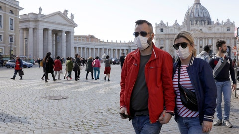 <p>               FILE - In this Thursday, Feb. 27, 2020 file photo, a couple wearing face masks stroll outside St. Peter's Square, at the Vatican. A U.S. government advisory urging Americans to reconsider travel to Italy is the ''final blow'' to the nation's tourism industry due to a new virus, the head of Italy's hotel federation said Saturday, Feb. 29, 2020. (AP Photo/Gregorio Borgia, file)             </p>