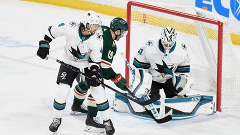 <p>               San Jose Sharks' goalie Martin Jones, right, makes a glove save on a shot by Minnesota Wild's Jason Zucker (16) behind the Sharks' Brenden Dillon in the third period of an NHL hockey game, Saturday, Feb. 15, 2020, in St. Paul, Minn. San Jose won 2-0.(AP Photo/Tom Olmscheid)             </p>