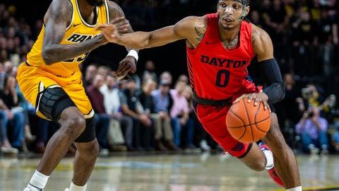<p>               Dayton guard Rodney Chatman (0) drives around VCU forward Issac Vann (23) during the first half of an NCAA college basketball game, Tuesday, Feb. 18, 2020, in Richmond, Va. (AP Photo/Zach Gibson)             </p>