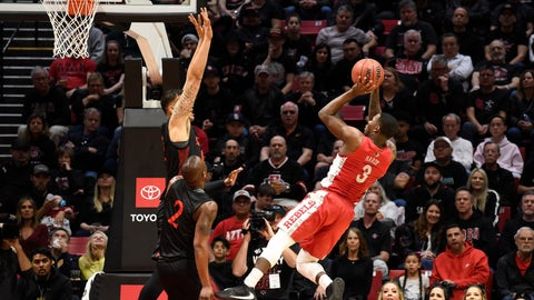 <p>               UNLV guard Amauri Hardy (3) shoots over San Diego State forward Nolan Narain (12) during the first half of an NCAA college basketball game Saturday, Feb. 22, 2020, in San Diego. (AP Photo/Denis Poroy)             </p>