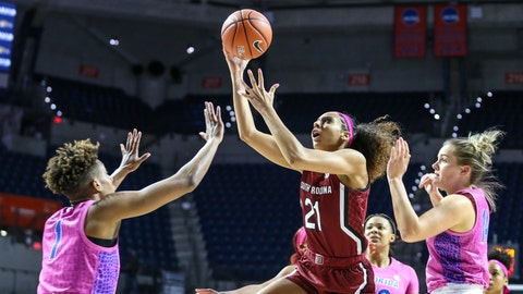 <p>               South Carolina forward Mikiah Herbert Harrigan (21) shoots over Florida guard Kiara Smith (1) while defended by Kristina Moore (14), right, during the first half of an NCAA college basketball game Thursday, Feb. 27, 2020, in Gainesville, Fla. (AP Photo/Gary McCullough)             </p>