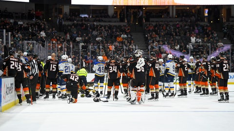 <p>               Members of the St. Louis Blues and Anaheim Ducks gather on the ice as Blues defenseman Jay Bouwmeester, who suffered a medical emergency, is worked on by medical personnel during the first period of an NHL hockey game Tuesday, Feb. 11, 2020, in Anaheim, Calif. (AP Photo/Mark J. Terrill)             </p>