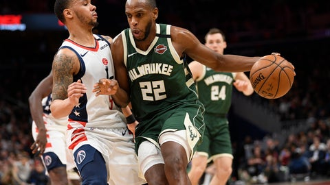 <p>               Milwaukee Bucks forward Khris Middleton (22) dribbles against Washington Wizards guard Shabazz Napier (5) during the first half of an NBA basketball game, Monday, Feb. 24, 2020, in Washington. (AP Photo/Nick Wass)             </p>