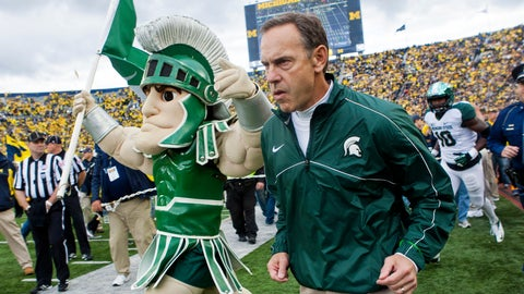 <p>               FILE - In this Oct. 20, 2012, file photo, Michigan State head coach Mark Dantonio, right, runs out on to the Michigan Stadium field alongside the school mascot, Sparty, before an NCAA college football game with Michigan in Ann Arbor, Mich. Dantonio announced his retirement Tuesday, Feb. 4, 2020, ending a 13-year run in which he guided the Spartans to heights they hadn't reached in decades.   (AP Photo/Tony Ding, File)             </p>