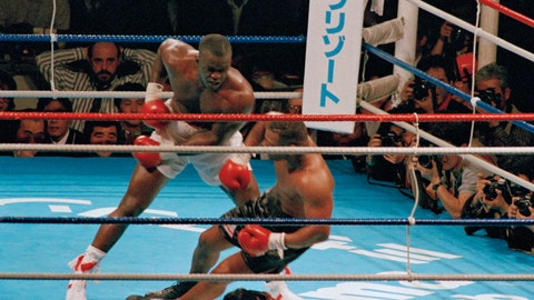<p>               FILE - In this Feb. 11, 1990, file photo, James Douglas, left, follows with a left, dropping Mike Tyson to the canvas in the 10th round of scheduled 12-round heavyweight champion bout at the Tokyo Dome in Tokyo. In one of the more spectacular upsets in sports history, Douglas defeated Tyson, the reigning world heavyweight champion. (AP Photo/Tsugufumi Matsumoto, File)             </p>