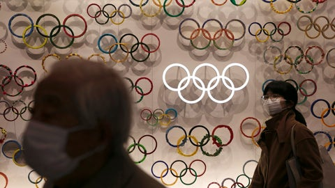 <p>               Two people wear masks as they visit the newly opened Japan Olympic Museum located near the New National Stadium, Sunday, Feb. 23, 2020, in Tokyo. (AP Photo/Jae C. Hong)             </p>