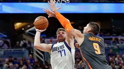 <p>               Dallas Mavericks guard Luka Doncic (77) shoots over Orlando Magic center Nikola Vucevic (9) during the first half of an NBA basketball game, Friday, Feb. 21, 2020, in Orlando, Fla. (AP Photo/John Raoux)             </p>