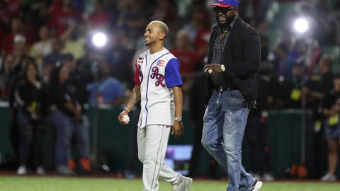 <p>               Retired Boston Red Sox player David Ortiz of the Dominican Republic, affectionately known as Big Papi, right, and Puerto Rican singer Ozuna, walk onto the field for the opening pitch of the Caribbean Series baseball game between Dominican Republic and Puerto Rico, in San Juan, Puerto Rico, Wednesday, Feb. 5, 2020.(AP Photo/Fernando Llano)             </p>