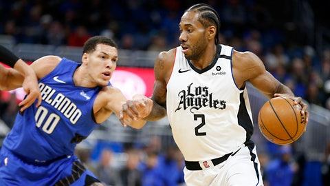 <p>               Los Angeles Clippers forward Kawhi Leonard (2) drives past Orlando Magic forward Aaron Gordon (00) during the first quarter of an NBA basketball game in Orlando, Fla., Sunday, Jan. 26, 2020. (AP Photo/Reinhold Matay)             </p>