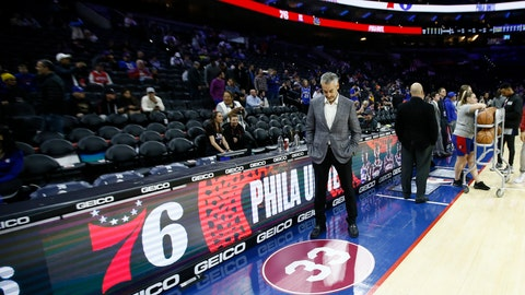<p>               A fan looks at a tribute to former NBA basketball player Kobe Bryant before a game between the Philadelphia 76ers and the Golden State Warriors, Tuesday, Jan. 28, 2020, in Philadelphia. Bryant wore No. 33 while playing at Lower Merion High School. (AP Photo/Matt Slocum)             </p>