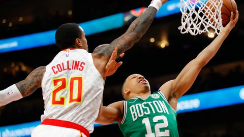 <p>               Boston Celtics forward Grant Williams (12) goes up for the shot as Atlanta Hawks forward John Collins (20) defends in the first half of an NBA basketball game on Monday, Feb. 3, 2020, in Atlanta. (AP Photo/Todd Kirkland)             </p>