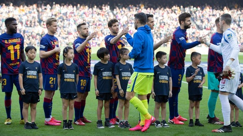 """<p>               Barcelona players wearing Ousmane Dembele shirts in support of their seriously injured team mate shake hands with Getafe players in the company of boys and girls of Chinese origin from the Penya Dracs Units Xinesos, the Chinese FC Barcalona supporters club based in Barcelona, wearing a shirt with the message Stronger Together in English and """"Support for China"""" in Chinese. during a Spanish La Liga soccer match between Barcelona and Getafe at the Camp Nou stadium in Barcelona, Spain, Saturday Feb. 15, 2020. (AP Photo/G.Garin)             </p>"""