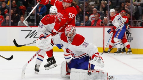 <p>               Montreal Canadiens goaltender Carey Price (31) deflects a shot as Detroit Red Wings left wing Tyler Bertuzzi (59) moves for the rebound during the second period of an NHL hockey game Tuesday, Feb. 18, 2020, in Detroit. (AP Photo/Paul Sancya)             </p>