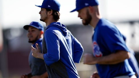 <p>               Chicago Cubs pitcher Yu Darvish, center, runs with other pitchers during a spring training baseball workout Wednesday, Feb. 12, 2020, in Mesa, Ariz. (AP Photo/Gregory Bull)             </p>