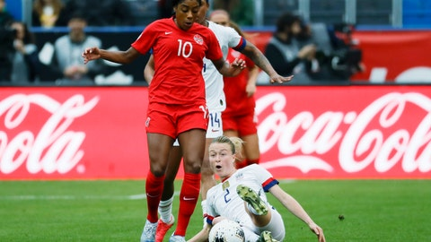 <p>               U.S. defender Emily Sonnett, right, kicks the ball away from Canada defender Ashley Lawrence during the first half of a CONCACAF women's Olympic qualifying soccer match Sunday, Feb. 9, 2020, in Carson, Calif. (AP Photo/Chris Carlson)             </p>
