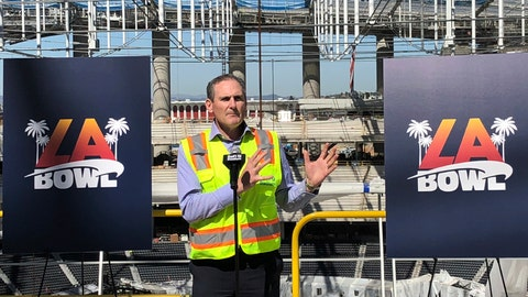 <p>               Pac-12 Commissioner Larry Scott speaks Wednesday, Feb. 26, 2020, about the new college football bowl game to be held at SoFi Stadium in Inglewood, Calif. The LA Bowl will match opponents from the Pac-12 and Mountain West conferences in December at the multibillion-dollar stadium, which is scheduled to open in July. (AP Photo/Greg Beacham)             </p>