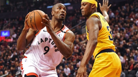 <p>               Toronto Raptors center Serge Ibaka (9) drives against Indiana Pacers center Myles Turner (33) during first-half NBA basketball game action in Toronto, Sunday, Feb. 23, 2020. (Frank Gunn/The Canadian Press via AP)             </p>