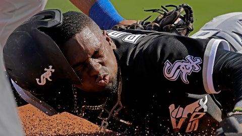 <p>               Chicago White Sox's Luis Robert is tagged by Texas Rangers third baseman Todd Frazier after sliding back to third on a double play hit into by Chicago White Sox's Adam Engel during the second inning of a spring training baseball game Saturday, Feb. 29, 2020, in Surprise, Ariz. Robert was ruled out at home on the play. (AP Photo/Charlie Riedel)             </p>