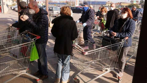 <p>               People queue outside a supermarket in Casalpusterlengo, Northern Italy, Monday, Feb. 24, 2020. Italy scrambled to check the spread of Europe's first major outbreak of the new viral disease amid rapidly rising numbers of infections and a third death. Road blocks were set up in at least some of 10 towns in Lombardy at the epicenter of the outbreak, including in Casalpusterlengo, to keep people from leaving or arriving. (AP Photo/Paolo Santalucia)             </p>