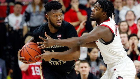 <p>               North Carolina State's DJ Funderburk, right, battles with Florida State's RaiQuan Gray (1) for the ball during the first half of an NCAA college basketball game in Raleigh, N.C., Saturday, Feb. 22, 2020. (AP Photo/Karl B DeBlaker)             </p>