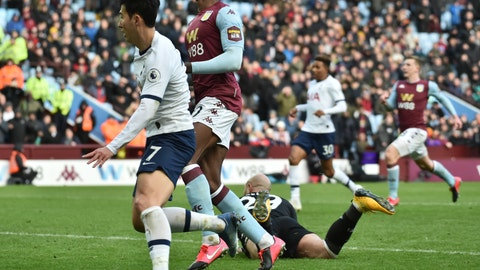<p>               Tottenham's Son Heung-min, left, scores his side's third goal during the English Premier League soccer match between Aston Villa and Tottenham Hotspur at Villa Park in Birmingham, England, Sunday, Feb. 16, 2020. (AP Photo/Rui Vieira)             </p>