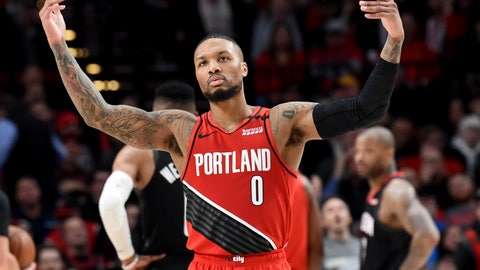 <p>               Portland Trail Blazers guard Damian Lillard urges on the crowd after scoring during the second half of the team's NBA basketball game against the Houston Rockets in Portland, Ore., Wednesday, Jan. 29, 2020. The Blazers won 125-112. (AP Photo/Steve Dykes)             </p>