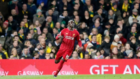 <p>               Liverpool's Sadio Mane celebrates after scoring his side's opening goal during the English Premier League soccer match between Norwich City and Liverpool at Carrow Road Stadium in Norwich, England, Saturday, Feb. 15, 2020. (AP Photo/Frank Augstein)             </p>