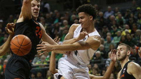 <p>               Oregon's Will Richardson, center, passes the ball between Oregon State's Kylor Kelley, left, and Tres Tinkle, right, during the first half of an NCAA college basketball game in Eugene, Ore., Thursday, Feb. 27, 2020. (AP Photo/Chris Pietsch)             </p>