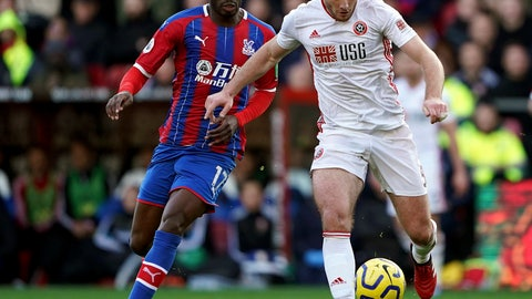 <p>               Crystal Palace's Christian Benteke, left and Sheffield United's Jack O'Connell battle for the ball, during the English Premier League soccer match between Crystal Palace and Sheffield United, at Selhurst Park, in London, Saturday, Feb. 1, 2020. (Tess Derry/PA via AP)             </p>