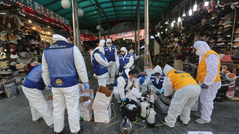<p>               In this Feb. 5, 2020, photo, workers wearing protective gears prepare to spray disinfectant as a precaution against the coronavirus at Namdaemun Market in Seoul, South Korea. Even as cases and deaths from the new virus mount, fear is advancing like a tsunami - and not just in the areas surrounding the Chinese city of Wuhan, the center of the outbreak that has been declared a global health emergency.  (AP Photo/Ahn Young-joon)             </p>