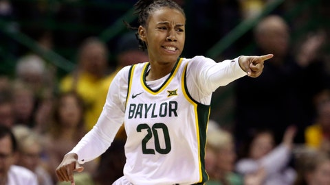<p>               Baylor guard Juicy Landrum points to a teammate after scoring a three-point basket over Kansas State in the first half of an NCAA college basketball game, Saturday, Feb. 29, 2020, in Waco, Texas. (AP Photo/Rod Aydelotte)             </p>