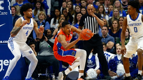 <p>               Florida's Kerry Blackshear Jr., middle, stumbles between Kentucky's Nick Richards (4) and Ashton Hagans (0) in the first half of an NCAA college basketball game in Lexington, Ky., Saturday, Feb. 22, 2020. (AP Photo/James Crisp)             </p>