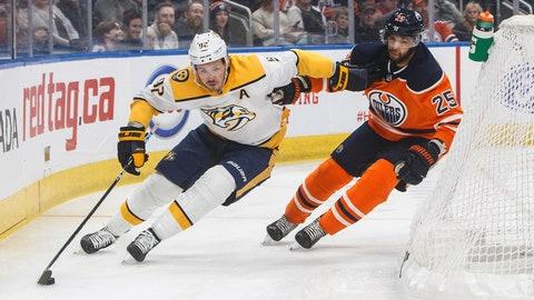 <p>               Nashville Predators' Ryan Johansen (92) and Edmonton Oilers' Darnell Nurse (25) battle for the puck during first-period NHL hockey game action in Edmonton, Alberta, Saturday, Feb. 8, 2020. (Jason Franson/The Canadian Press via AP)             </p>