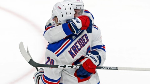 <p>               New York Rangers center Mika Zibanejad (93) embraces New York Rangers left wing Chris Kreider (20) after scoring the winning goal in overtime of an NHL hockey game against the New York Islanders, Tuesday, Feb. 25, 2020, in Uniondale, N.Y. The Rangers won 4-3. (AP Photo/Kathy Willens)             </p>