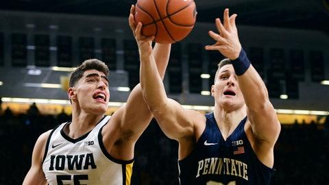 <p>               Iowa's Luka Garza (55) and Penn State's John Harrar reach for a rebound during the first half of an NCAA college basketball game, Saturday, Feb. 29, 2020, in Iowa City, Iowa. (AP Photo/Cliff Jette)             </p>
