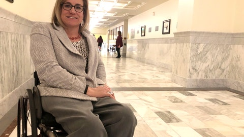 <p>               Democratic state Rep. Muffy poses in the hallway of the Idaho Statehouse in Boise, Idaho, Wednesday, Feb. 26, 2020. Idaho moved closer Wednesday to banning transgender women from competing in women's sports despite warnings that such a law is unconstitutional and uncertainties about how the NCAA might react. Davis, a seven-time medalist in Paralympic Games, said it could limit female participation because of the tests. (AP Photo/Keith Riddler)             </p>