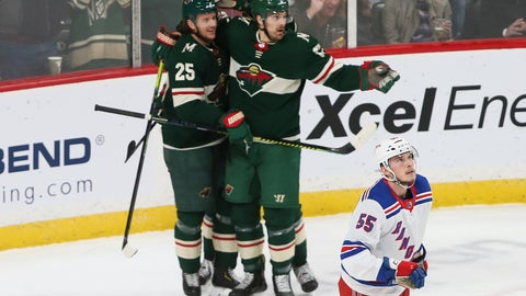 <p>               Minnesota Wild's Jonas Brodin,left, is congratulated by teammates after scoring against the New York Rangers during the first period of an NHL hockey game Thursday, Feb. 13, 2020, in St. Paul, Minn. Watching the scoreboard is Rangers' Ryan Lindgren. (AP Photo/Jim Mone)             </p>