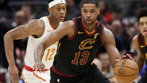 <p>               Cleveland Cavaliers' Tristan Thompson (13) drives against Atlanta Hawks' De'Andre Hunter (12) in the second half of an NBA basketball game, Wednesday, Feb. 12, 2020, in Cleveland. The Cavaliers won 127-105. (AP Photo/Tony Dejak)             </p>