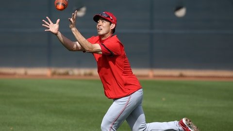 <p>               Cincinnati Reds center fielder Shogo Akiyama, of Japan, reaches up to catch a football as outfielders warm up during spring training baseball workouts Friday, Feb. 21, 2020, in Goodyear, Ariz. (AP Photo/Ross D. Franklin)             </p>