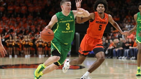 <p>               Oregon's Payton Pritchard (3) drives to the basket past Oregon State's Ethan Thompson (5) during the first half of an NCAA college basketball game in Corvallis, Ore., Saturday, Feb. 8, 2020. (AP Photo/Amanda Loman)             </p>