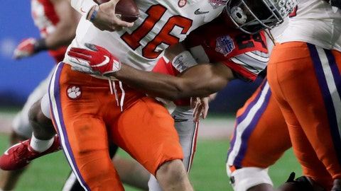 <p>               FILE - In this Dec. 28, 2019, file photo, Ohio State cornerback Shaun Wade, right, tackles Clemson quarterback Trevor Lawrence during the first half of the Fiesta Bowl NCAA college football playoff semifinal in Glendale, Ariz. Wade was ejected from the game for targeting. Players ejected from games for targeting will be allowed to remain in the bench area and replay reviews will be limited to two minutes if proposals by the NCAA football rules committee are passed. (AP Photo/Rick Scuteri, File)             </p>