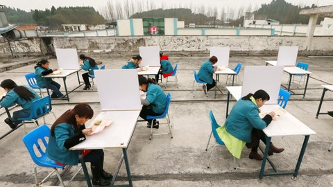 <p>               In this Friday, Feb. 14, 2020, photo, factory workers are separated by partitions as a precaution against infection as they take their lunch break on the roof of an electronics factory in Suining in southwestern China's Sichuan Province. China reported Saturday a figure of 2,641 new virus cases, a major drop from the higher numbers in recent days since a broader diagnostic method was implemented. (Chinatopix via AP)             </p>