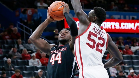 <p>               Texas Tech guard Chris Clarke (44) goes up for a shot defended by Oklahoma forward Kur Kuath (52) in the second half of an NCAA college basketball game Tuesday, Feb. 25, 2020, in Oklahoma City. (AP Photo/Sue Ogrocki)             </p>