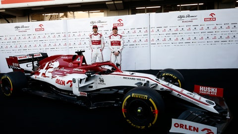 <p>               Kimi Raikkonen, right, and Antonio Giovinazzi stand after unveiling the new Alfa Romeo C39 ahead of the Formula One pre-season testing session at the Barcelona Catalunya racetrack in Montmelo, outside Barcelona, Spain, Wednesday, Feb. 19, 2020. (AP Photo/Joan Monfort)             </p>