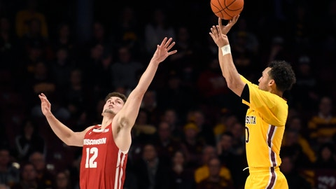 <p>               Wisconsin's Trevor Anderson (12) guards against 3-point shot by Minnesota's Payton Willis (0) during the second half of an NCAA college basketball game Wednesday, Feb. 5, 2020, in Minneapolis. Minnesota won 70-52. (AP Photo/Hannah Foslien)             </p>
