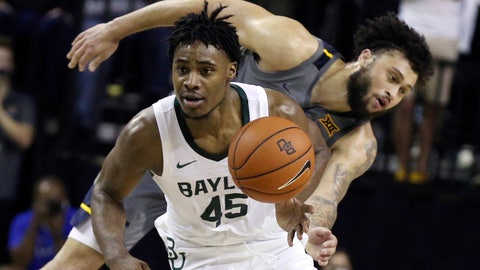 <p>               Baylor guard Davion Mitchell, left, breaks away from West Virginia guard Jermaine Haley for a fast break in the second half of an NCAA college basketball game, Saturday, Feb. 15, 2020, in Waco, Texas. (AP Photo/Rod Aydelotte)             </p>